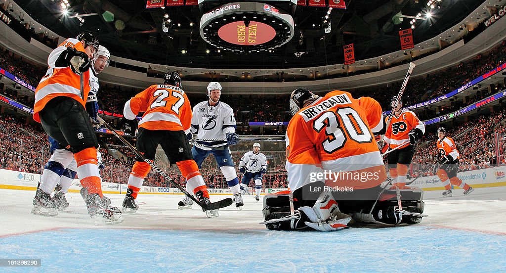 Ilya Bryzgalov #30 of the Philadelphia Flyers covers up the puck from a shot on goal by Ryan Malone #12 of the Tampa Bay Lightning on February 5, 2013 at the Wells Fargo Center in Philadelphia, Pennsylvania.