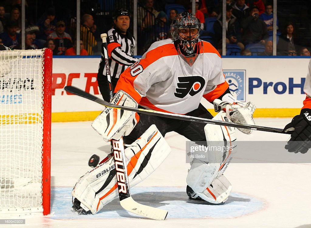 Ilya Bryzgalov #30 of the Philadelphia Flyers defends the net against the New York Islanders during their game at Nassau Veterans Memorial Coliseum on February 18, 2013 in Uniondale, New York.