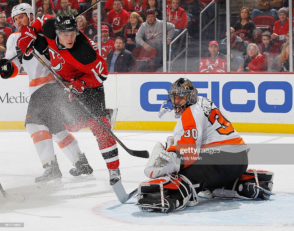 Ilya Bryzgalov #30 of the Philadelphia Flyers eyes the puck after making a save as <a gi-track='captionPersonalityLinkClicked' href=/galleries/search?phrase=Alexei+Ponikarovsky&family=editorial&specificpeople=210628 ng-click='$event.stopPropagation()'>Alexei Ponikarovsky</a> #12 of the New Jersey Devils looks for a rebound during the game at the Prudential Center on February 15, 2013 in Newark, New Jersey.