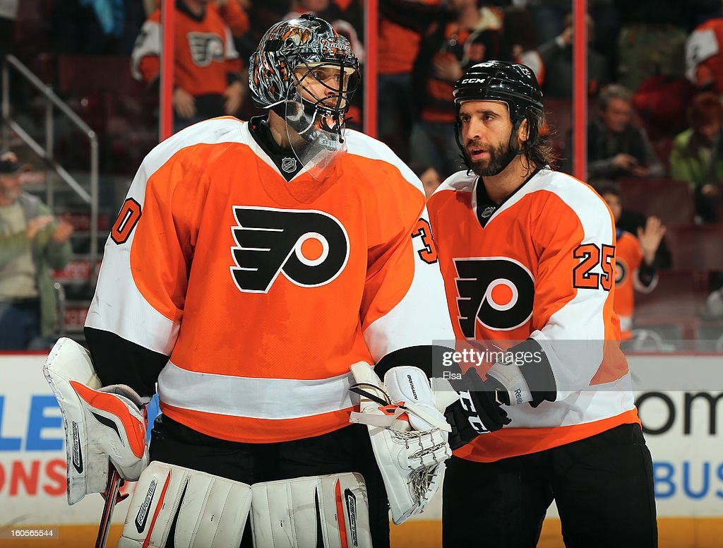 <a gi-track='captionPersonalityLinkClicked' href=/galleries/search?phrase=Ilya+Bryzgalov&family=editorial&specificpeople=2285430 ng-click='$event.stopPropagation()'>Ilya Bryzgalov</a> #30 of the Philadelphia Flyers is congratulated by teammates <a gi-track='captionPersonalityLinkClicked' href=/galleries/search?phrase=Maxime+Talbot&family=editorial&specificpeople=2078922 ng-click='$event.stopPropagation()'>Maxime Talbot</a> #25 after the game against the Carolina Hurricanes on February 2, 2013 at the Wells Fargo Center in Philadelphia, Pennsylvania.The Philadelphia Flyers defeated the Carolina Hurricanes 5-3.