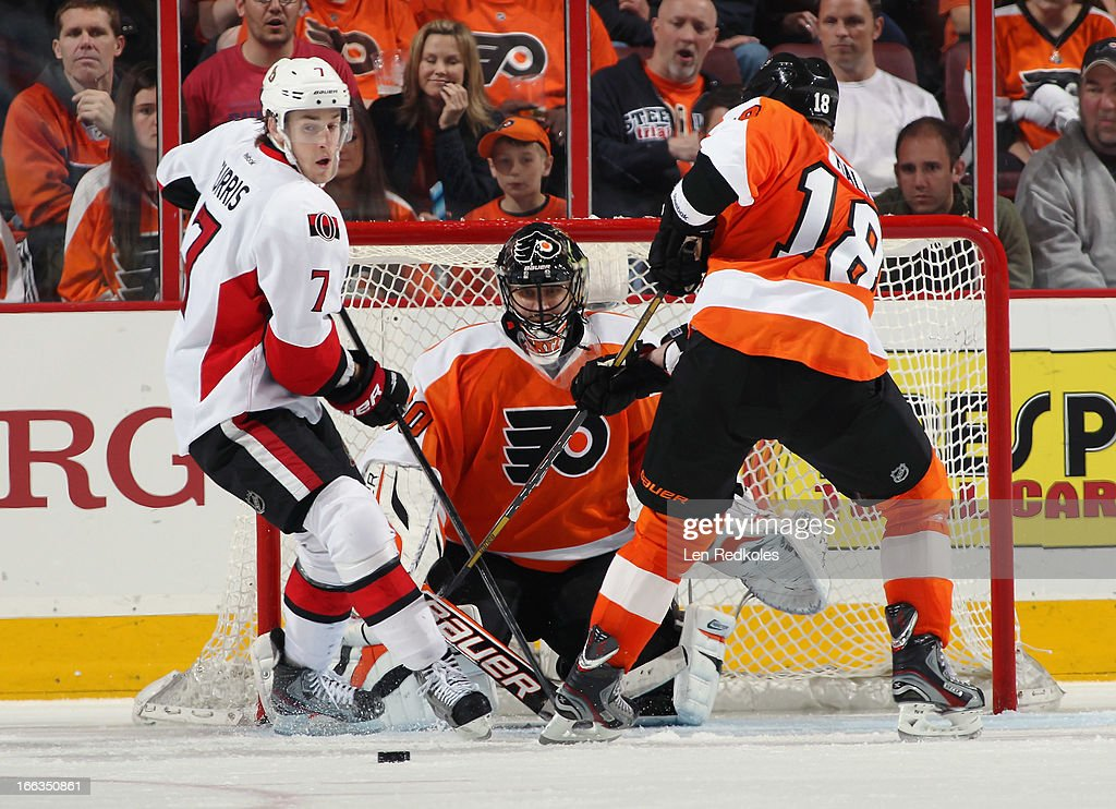 <a gi-track='captionPersonalityLinkClicked' href=/galleries/search?phrase=Ilya+Bryzgalov&family=editorial&specificpeople=2285430 ng-click='$event.stopPropagation()'>Ilya Bryzgalov</a> #30 of the Philadelphia Flyers keeps his eyes on the loose puck while <a gi-track='captionPersonalityLinkClicked' href=/galleries/search?phrase=Adam+Hall&family=editorial&specificpeople=202919 ng-click='$event.stopPropagation()'>Adam Hall</a> #18 battles with <a gi-track='captionPersonalityLinkClicked' href=/galleries/search?phrase=Kyle+Turris&family=editorial&specificpeople=4251834 ng-click='$event.stopPropagation()'>Kyle Turris</a> #7 of the Ottawa Senators on April 11, 2013 at the Wells Fargo Center in Philadelphia, Pennsylvania. The Senators went on to defeat the Flyers 3-1.