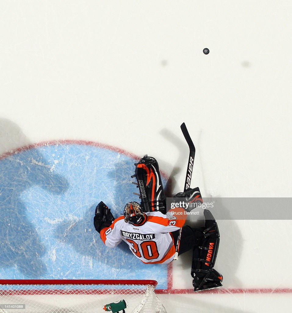 <a gi-track='captionPersonalityLinkClicked' href=/galleries/search?phrase=Ilya+Bryzgalov&family=editorial&specificpeople=2285430 ng-click='$event.stopPropagation()'>Ilya Bryzgalov</a> #30 of the Philadelphia Flyers kicked out a shot during his 3-2 victory over the New York Islanders at the Nassau Veterans Memorial Coliseum on March 15, 2012 in Uniondale, New York.