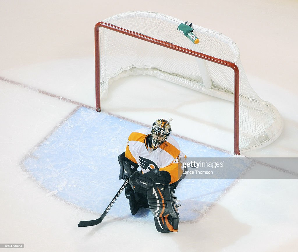 <a gi-track='captionPersonalityLinkClicked' href=/galleries/search?phrase=Ilya+Bryzgalov&family=editorial&specificpeople=2285430 ng-click='$event.stopPropagation()'>Ilya Bryzgalov</a> #30 of the Philadelphia Flyers kneels on the ice dejectedly after giving up a third period goal to the Winnipeg Jets at the MTS Centre on February 21, 2012 in Winnipeg, Manitoba, Canada.