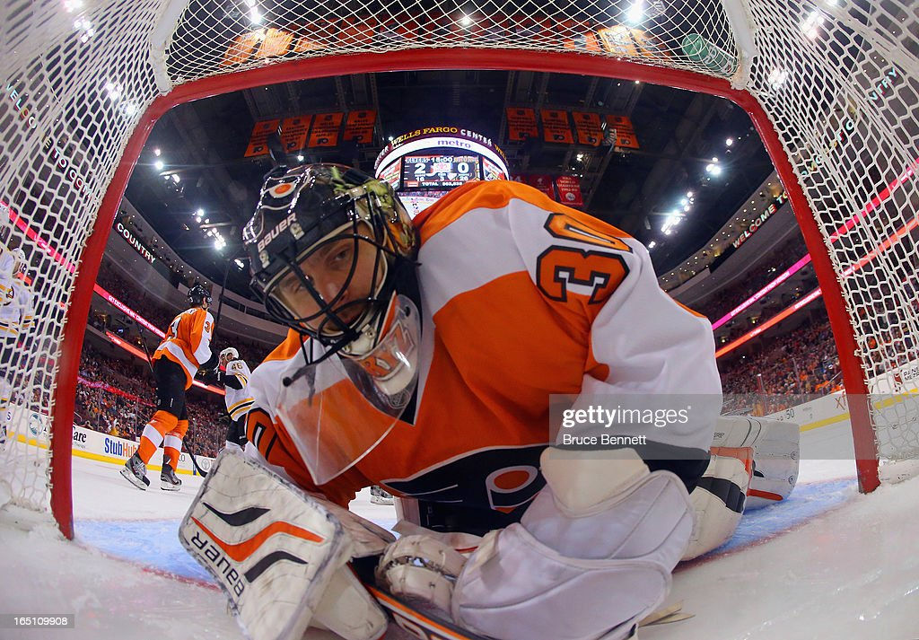 <a gi-track='captionPersonalityLinkClicked' href=/galleries/search?phrase=Ilya+Bryzgalov&family=editorial&specificpeople=2285430 ng-click='$event.stopPropagation()'>Ilya Bryzgalov</a> #30 of the Philadelphia Flyers looks back in the net after a goal by <a gi-track='captionPersonalityLinkClicked' href=/galleries/search?phrase=Nathan+Horton&family=editorial&specificpeople=204741 ng-click='$event.stopPropagation()'>Nathan Horton</a> #18 of the Boston Bruins at 5:00 of the third period at the Wells Fargo Center on March 30, 2013 in Philadelphia, Pennsylvania. The Flyers defeated the Bruins 3-1.