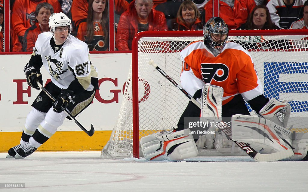 Ilya Bryzgalov #30 of the Philadelphia Flyers makes a kick save as Sidney Crosby #87 of the Pittsburgh Penguins looks for a rebound on January 19, 2013 at the Wells Fargo Center in Philadelphia, Pennsylvania.