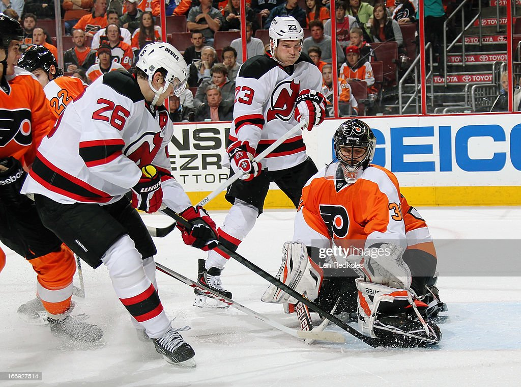 <a gi-track='captionPersonalityLinkClicked' href=/galleries/search?phrase=Ilya+Bryzgalov&family=editorial&specificpeople=2285430 ng-click='$event.stopPropagation()'>Ilya Bryzgalov</a> #30 of the Philadelphia Flyers makes a pad save on a shot by Patrick Elias #26 of the New Jersey Devils as David Clarkson #23 awaits a rebound on April 18, 2013 at the Wells Fargo Center in Philadelphia, Pennsylvania.