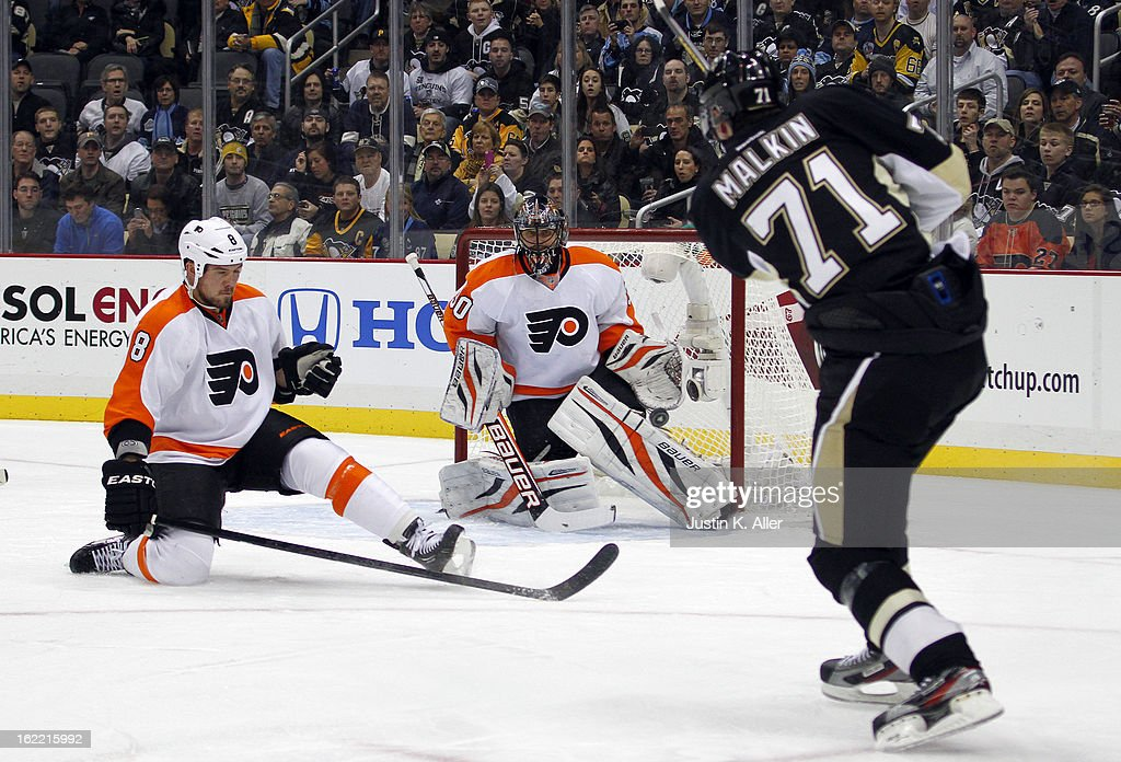 Ilya Bryzgalov #30 of the Philadelphia Flyers makes a save on Evgeni Malkin #71 of the Pittsburgh Penguins during the game at Consol Energy Center on February 20, 2013 in Pittsburgh, Pennsylvania.