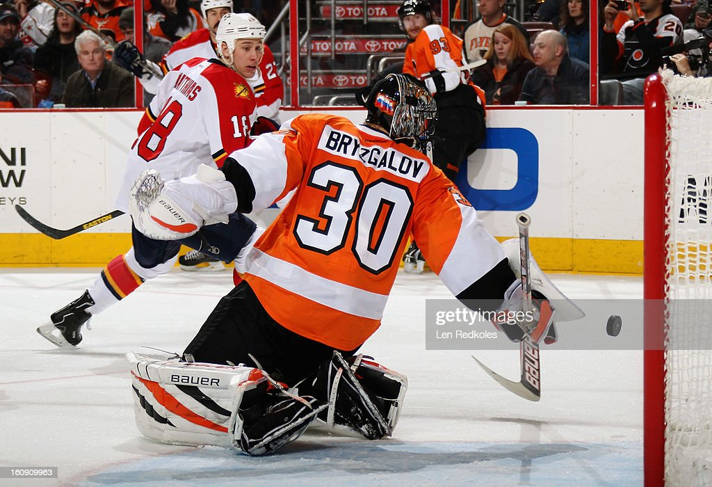 Ilya Bryzgalov #30 of the Philadelphia Flyers makes a stick save against Shawn Matthias #18 of the Florida Panthers on February 7, 2013 at the Wells Fargo Center in Philadelphia, Pennsylvania.