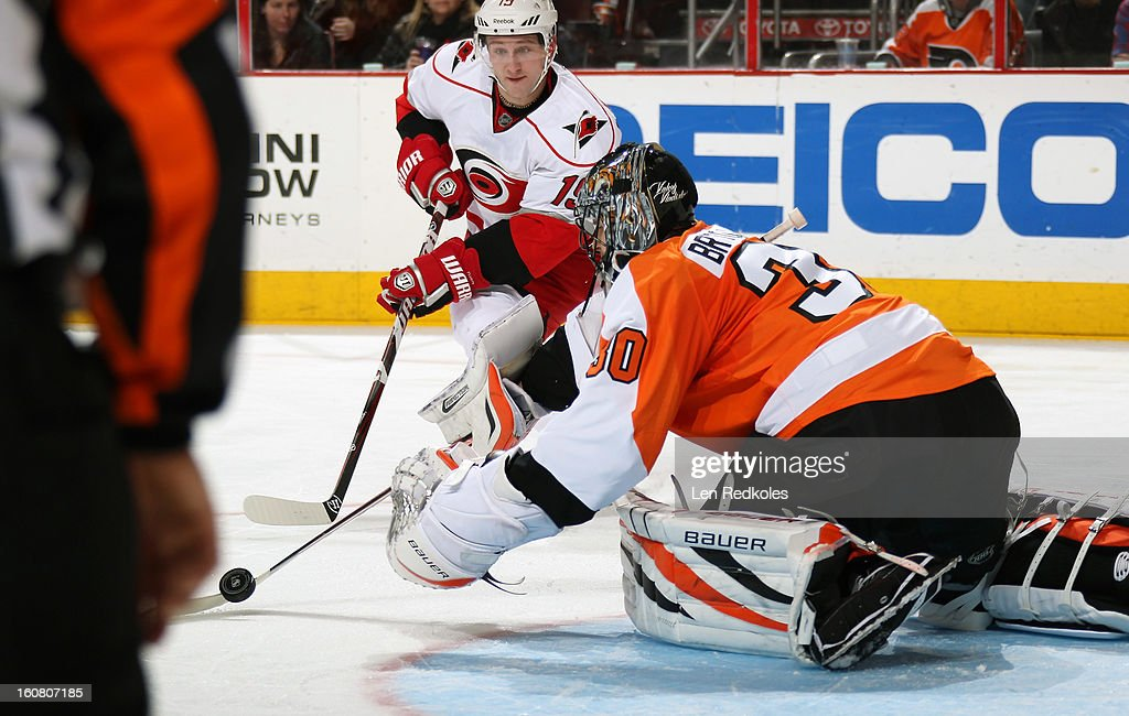 Ilya Bryzgalov #30 of the Philadelphia Flyers makes a stick save off the shot on goal by Jiri Tlusty #19 of the Carolina Hurricanes on February 2, 2013 at the Wells Fargo Center in Philadelphia, Pennsylvania.