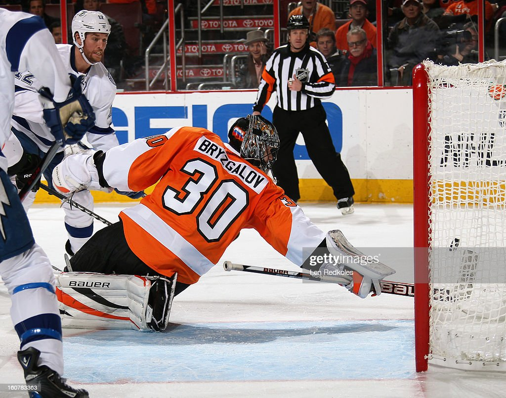 Ilya Bryzgalov #30 of the Philadelphia Flyers makes a stick save on a shot by Ryan Malone #12 of the Tampa Bay Lightning on February 5, 2013 at the Wells Fargo Center in Philadelphia, Pennsylvania.