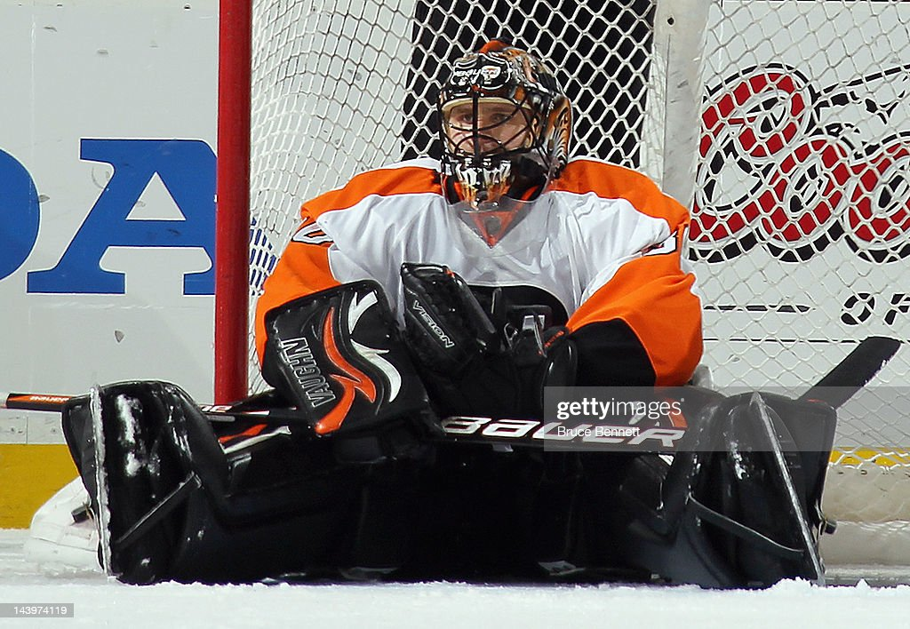 <a gi-track='captionPersonalityLinkClicked' href=/galleries/search?phrase=Ilya+Bryzgalov&family=editorial&specificpeople=2285430 ng-click='$event.stopPropagation()'>Ilya Bryzgalov</a> #30 of the Philadelphia Flyers pauses in the crease following a second period save against the New Jersey Devils in Game Four of the Eastern Conference Semifinals during the 2012 NHL Stanley Cup Playoffs at Prudential Center on May 6, 2012 in Newark, New Jersey.