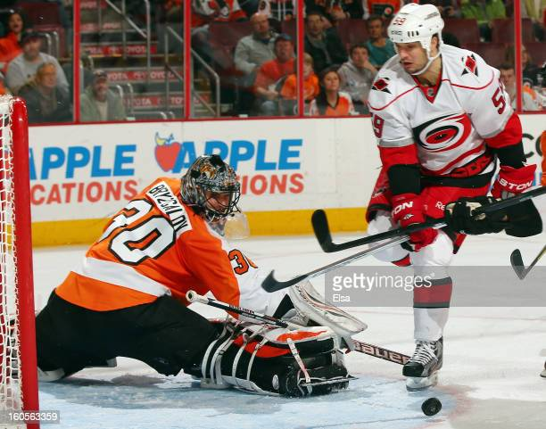 Ilya Bryzgalov of the Philadelphia Flyers stops a shot by Chad LaRose of the Carolina Hurricanes on February 2 2013 at the Wells Fargo Center in...