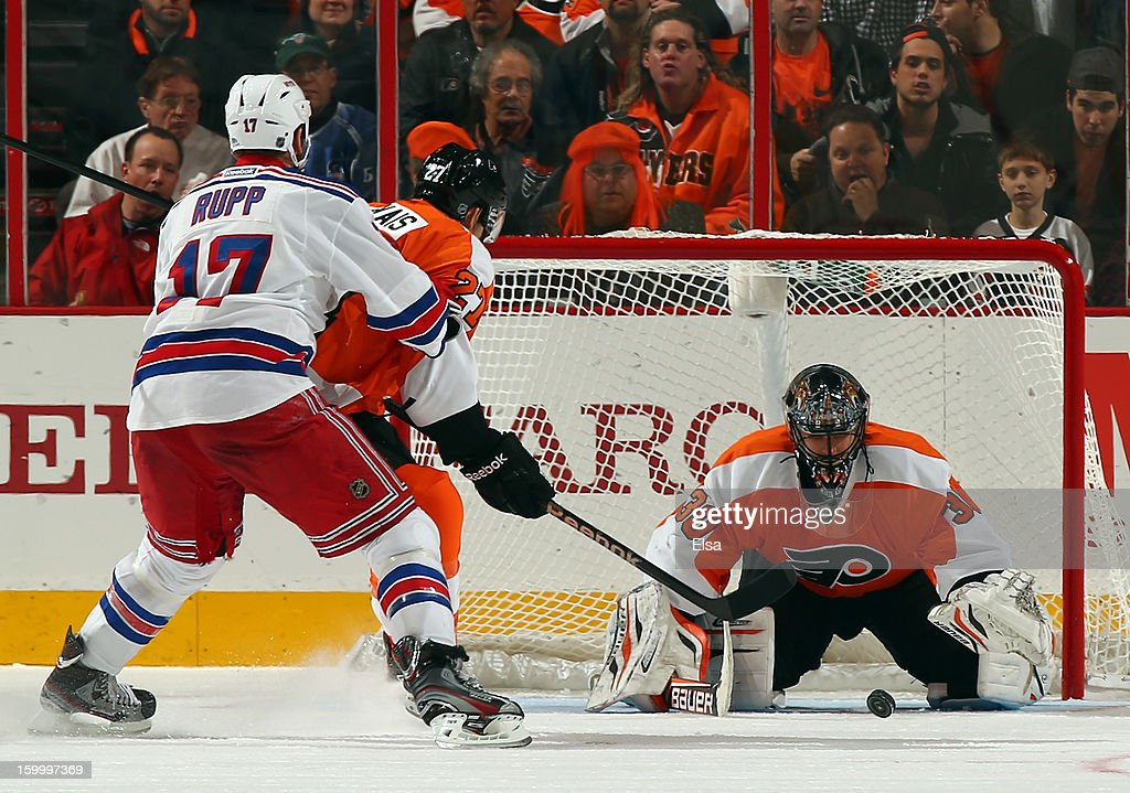 Ilya Bryzgalov #30 of the Philadelphia Flyers stops a shot by Mike Rupp #17 of the New York Rangers as <a gi-track='captionPersonalityLinkClicked' href=/galleries/search?phrase=Bruno+Gervais&family=editorial&specificpeople=215079 ng-click='$event.stopPropagation()'>Bruno Gervais</a> #27 of the Flyers defends on January 24, 2013 at the Wells Fargo Center in Philadelphia, Pennsylvania.