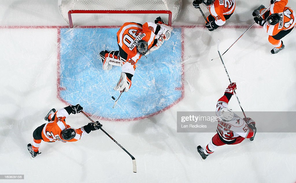 Ilya Bryzgalov #30 of the Philadelphia Flyers stops a shot on goal by Jeff Skinner #53 of the Carolina Hurricanes on February 2, 2013 at the Wells Fargo Center in Philadelphia, Pennsylvania.