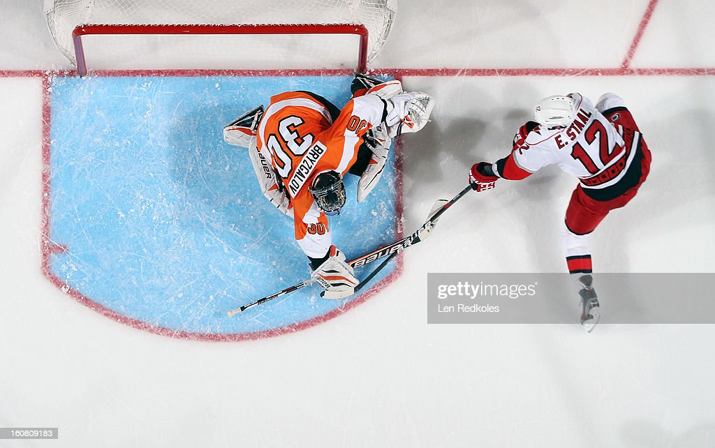 Ilya Bryzgalov #30 of the Philadelphia Flyers stops a shot on goal by Eric Staal #12 of the Carolina Hurricanes on February 2, 2013 at the Wells Fargo Center in Philadelphia, Pennsylvania.