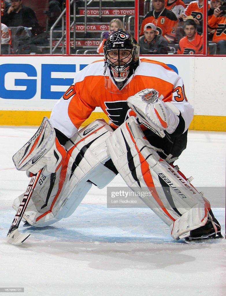 Ilya Bryzgalov #30 of the Philadelphia Flyers watches the play develop in the corner against the Ottawa Senators on March 2, 2013 at the Wells Fargo Center in Philadelphia, Pennsylvania.
