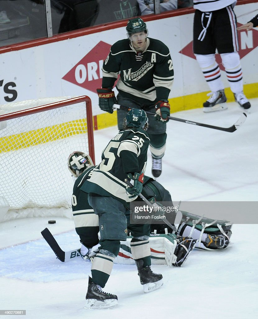 Ilya Bryzgalov #30, Ryan Suter #20 and Jonas Brodin #25 of the Minnesota Wild react after a goal by Patrick Kane #88 of the Chicago Blackhawks during overtime in Game Six of the Second Round of the 2014 NHL Stanley Cup Playoffs on May 13, 2014 at Xcel Energy Center in St Paul, Minnesota. The Blackhawks defeated the Wild 2-1 in overtime.