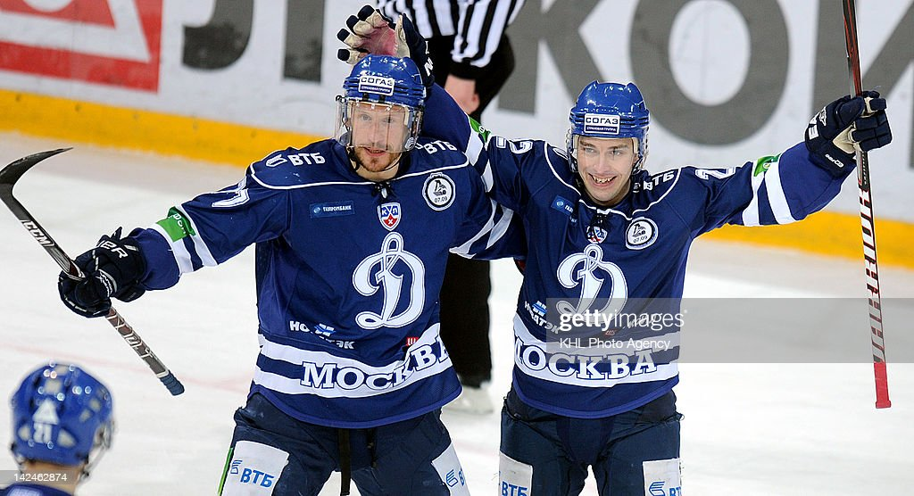 Ilya Gorokhov #77 and Mikhail Anisin #22 of the Dinamo celebrate a goal during the playoff game between SKA St. Petersbourg and Dinamo Moscow during the KHL Championship 2011/2012 on April 3, 2012 at the Arena Luzhniki in Moscow, Russia. The Dinamo won 6-1.