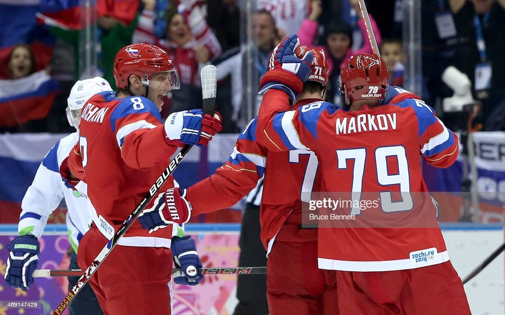 <a gi-track='captionPersonalityLinkClicked' href=/galleries/search?phrase=Ilya+Kovalchuk&family=editorial&specificpeople=201796 ng-click='$event.stopPropagation()'>Ilya Kovalchuk</a> #71 of Russia celebrates scoring a goal in the second period with <a gi-track='captionPersonalityLinkClicked' href=/galleries/search?phrase=Alexander+Ovechkin&family=editorial&specificpeople=184488 ng-click='$event.stopPropagation()'>Alexander Ovechkin</a> #8 and <a gi-track='captionPersonalityLinkClicked' href=/galleries/search?phrase=Andrei+Markov&family=editorial&specificpeople=204528 ng-click='$event.stopPropagation()'>Andrei Markov</a> #79 against Slovenia during the Men's Ice Hockey Preliminary Round Group A game on day six of the Sochi 2014 Winter Olympics at Bolshoy Ice Dome on February 13, 2014 in Sochi, Russia.
