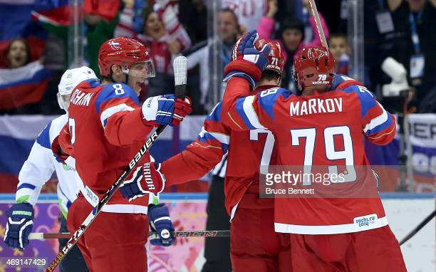 Ilya Kovalchuk of Russia celebrates scoring a goal in the second period with Alexander Ovechkin and Andrei Markov against Slovenia during the Men's...