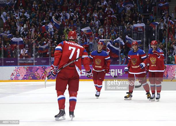 Ilya Kovalchuk of Russia celebrates with his teammates after scoring the winning goal in a shoot against Jan Laco of Slovakia during the Men's Ice...