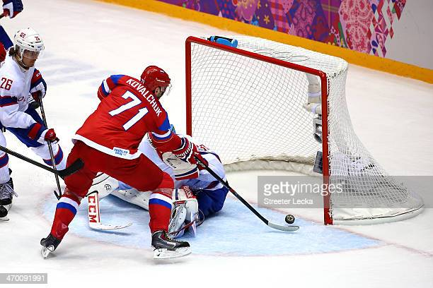 Ilya Kovalchuk of Russia scores a goal in the second period against Lars Haugen of Norway during the Men's Ice Hockey Qualification Playoff game on...