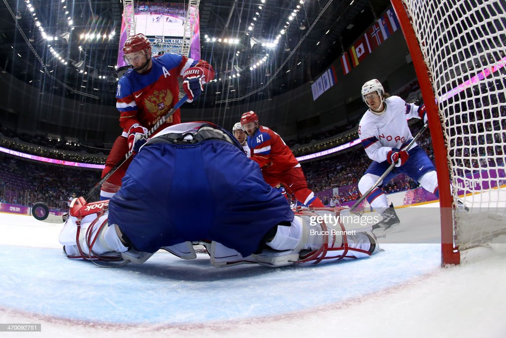 <a gi-track='captionPersonalityLinkClicked' href=/galleries/search?phrase=Ilya+Kovalchuk&family=editorial&specificpeople=201796 ng-click='$event.stopPropagation()'>Ilya Kovalchuk</a> #71 of Russia scores a goal in the second period against <a gi-track='captionPersonalityLinkClicked' href=/galleries/search?phrase=Lars+Haugen&family=editorial&specificpeople=7718894 ng-click='$event.stopPropagation()'>Lars Haugen</a> #30 of Norway during the Men's Ice Hockey Qualification Playoff game on day eleven of the Sochi 2014 Winter Olympics at Bolshoy Ice Dome on February 18, 2014 in Sochi, Russia.