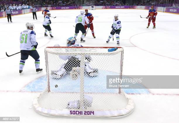 Ilya Kovalchuk of Russia shoots and scores against Robert Kristan of Slovenia in the second period during the Men's Ice Hockey Preliminary Round...