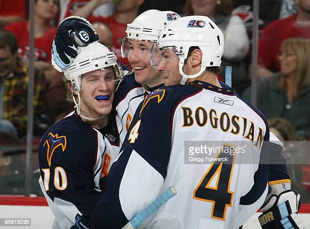 Ilya Kovalchuk of the Atlanta Thrashers celebrates his third period goal with teammates Bryan Little and Zach Bogosian during an NHL game against the...