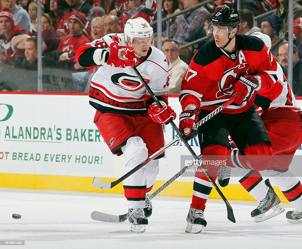 Ilya Kovalchuk #17 of the New Jersey Devils and Jussi Jokinen #36 of the Carolina Hurricanes battle for position on a loose puck during the game at the Prudential Center on February 12, 2013 in Newark, New Jersey.