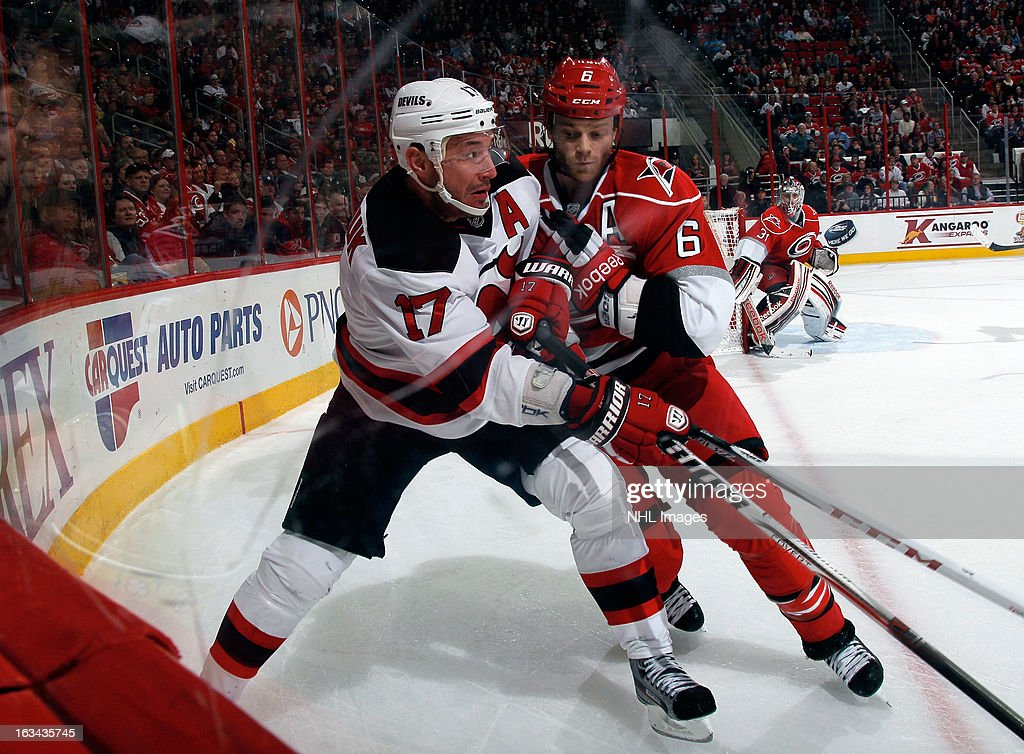 <a gi-track='captionPersonalityLinkClicked' href=/galleries/search?phrase=Ilya+Kovalchuk&family=editorial&specificpeople=201796 ng-click='$event.stopPropagation()'>Ilya Kovalchuk</a> #17 of the New Jersey Devils braces for a hit from <a gi-track='captionPersonalityLinkClicked' href=/galleries/search?phrase=Tim+Gleason&family=editorial&specificpeople=211575 ng-click='$event.stopPropagation()'>Tim Gleason</a> #6 of the Carolina Hurricanes during an NHL game on March 9, 2013 at PNC Arena in Raleigh, North Carolina.