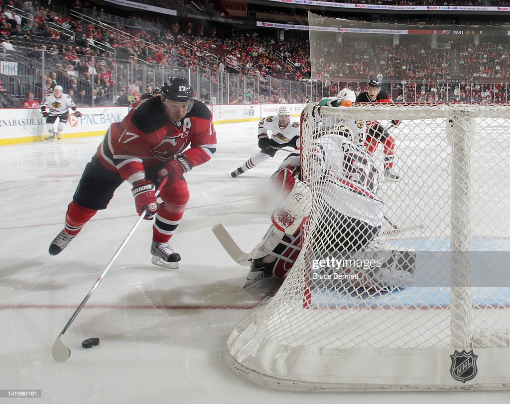 <a gi-track='captionPersonalityLinkClicked' href=/galleries/search?phrase=Ilya+Kovalchuk&family=editorial&specificpeople=201796 ng-click='$event.stopPropagation()'>Ilya Kovalchuk</a> #17 of the New Jersey Devils carries the puck around the net manned by <a gi-track='captionPersonalityLinkClicked' href=/galleries/search?phrase=Corey+Crawford&family=editorial&specificpeople=818935 ng-click='$event.stopPropagation()'>Corey Crawford</a> #50 of the Chicago Blackhawks at the Prudential Center on March 27, 2012 in Newark, New Jersey. The Devils defeated the Blackhawks 2-1 in the shootout.