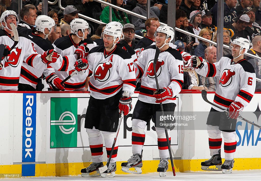 Ilya Kovalchuk #17 of the New Jersey Devils celebrates his goal with the bench during the second period against the Pittsburgh Penguins on February 10, 2013 at Consol Energy Center in Pittsburgh, Pennsylvania.