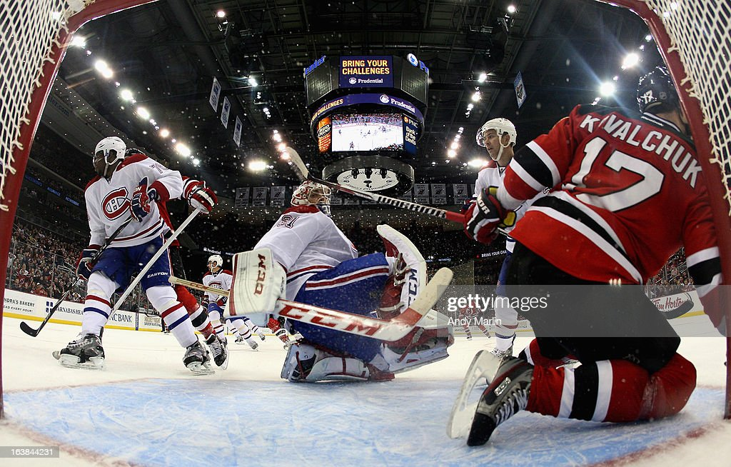 <a gi-track='captionPersonalityLinkClicked' href=/galleries/search?phrase=Ilya+Kovalchuk&family=editorial&specificpeople=201796 ng-click='$event.stopPropagation()'>Ilya Kovalchuk</a> #17 of the New Jersey Devils crashes into the net as goaltender Cary Price #31 of the Montreal Canadiens looks behind him during the game at the Prudential Center on March 16, 2013 in Newark, New Jersey.
