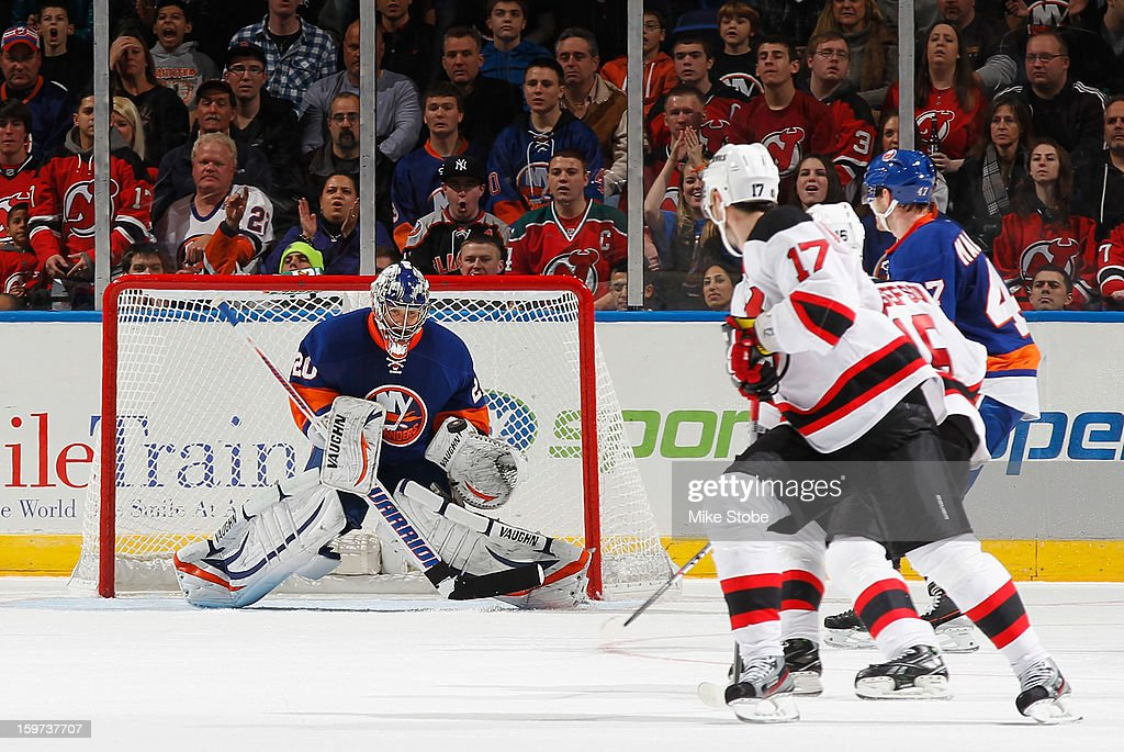 Ilya Kovalchuk #17 of the New Jersey Devils looks for the rebound as Evgeni Nabokov #20 of the New York Islanders makes a save at Nassau Veterans Memorial Coliseum on January 19, 2013 in Uniondale, New York.