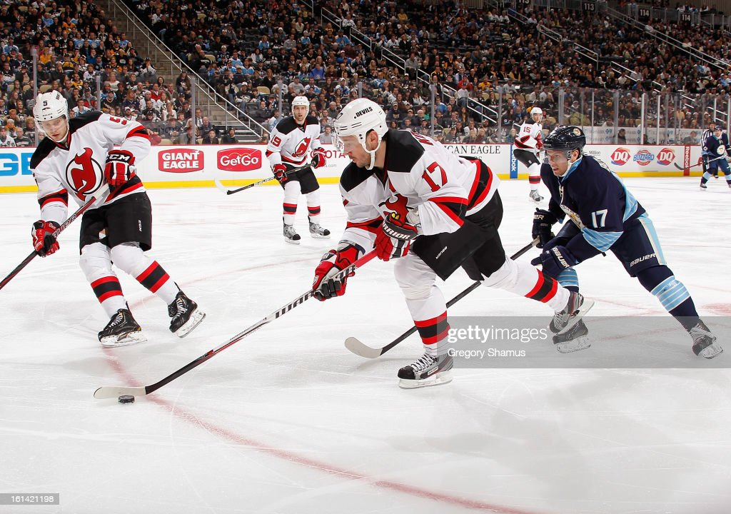 <a gi-track='captionPersonalityLinkClicked' href=/galleries/search?phrase=Ilya+Kovalchuk&family=editorial&specificpeople=201796 ng-click='$event.stopPropagation()'>Ilya Kovalchuk</a> #17 of the New Jersey Devils moves the puck up ice in front of <a gi-track='captionPersonalityLinkClicked' href=/galleries/search?phrase=Adam+Larsson&family=editorial&specificpeople=6705080 ng-click='$event.stopPropagation()'>Adam Larsson</a> #5 and Zach Boychuk #17 of the Pittsburgh Penguins on February 10, 2013 at Consol Energy Center in Pittsburgh, Pennsylvania. New Jersey won the game 3-1.