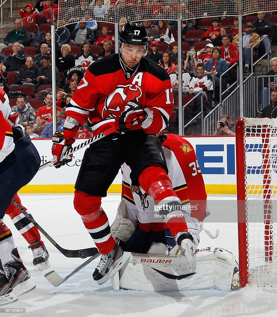 <a gi-track='captionPersonalityLinkClicked' href=/galleries/search?phrase=Ilya+Kovalchuk&family=editorial&specificpeople=201796 ng-click='$event.stopPropagation()'>Ilya Kovalchuk</a> #17 of the New Jersey Devils returns from injury and screens <a gi-track='captionPersonalityLinkClicked' href=/galleries/search?phrase=Jacob+Markstrom&family=editorial&specificpeople=5370948 ng-click='$event.stopPropagation()'>Jacob Markstrom</a> #35 of the Florida Panthers during the second period at the Prudential Center on April 20, 2013 in Newark, New Jersey.