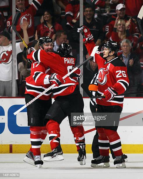 Ilya Kovalchuk of the New Jersey Devils scores on the powerplay at 832 of the third period against the Florida Panthers and is joined by Zach Parise...