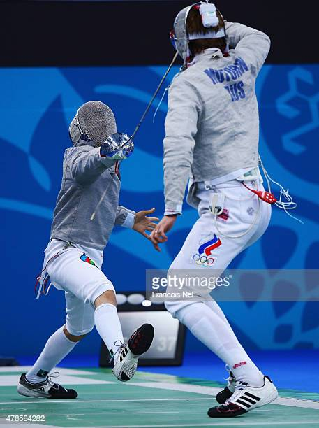 Ilya Motorin of Russia and Javanshir Aghakishiyev of Azerbaijan compete during the Men's Fencing Team Sabre quarter final on day fourteen of the Baku...