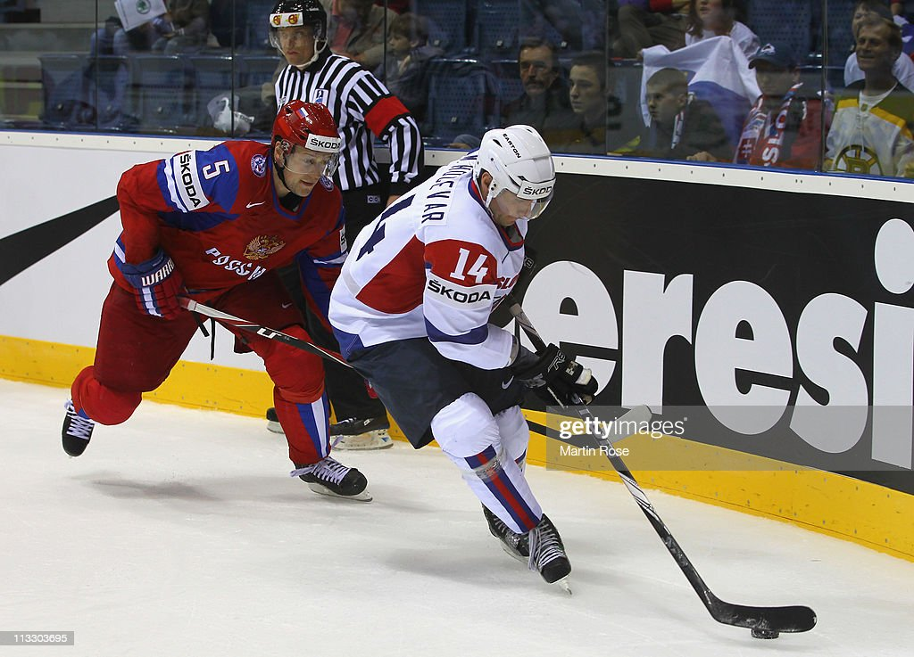 Ilya Nikulin (L) of Russia and Matej Hocevar (R) of Slovenia battle for the puck during the IIHF World Championship group A match between Russia and Slovenia at Orange Arena on May 1, 2011 in Bratislava, Slovakia.