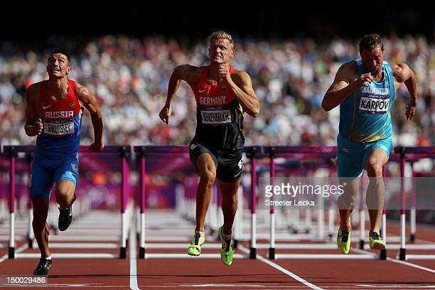 Ilya Shkurenev of Russia Pascal Behrenbruch of Germany Dmitriy Karpov of Kazakhstan compete during the Men's Decathlon 110m Hurdles heats on Day 13...