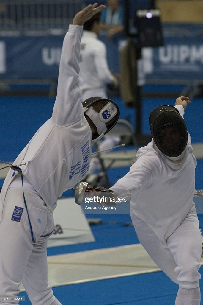Ilyashenko Pavel (L) from Kazakhstan and Bailey Eanna from Ireland compete in the fencing at the mixed relay World Championship in modern pentathlon in Olympic Sports Complex in Moscow, Russia, on May 29, 2016.