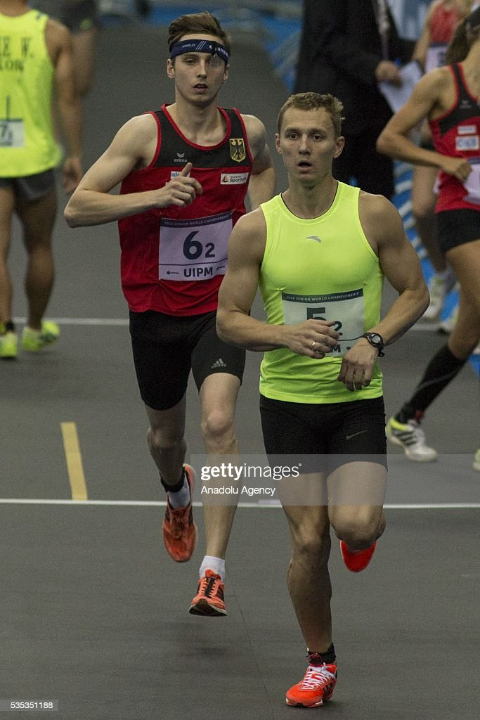 Ilyashenko Pavel from Kazakhstan (first) and Liebig Fabian from Germany competes in the combined event at the mixed relay World Championship in modern pentathlon in Moscow in Olympic Sports Complex in Moscow, Russia, on May 29, 2016.