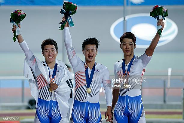 Im Chaebin Kang Dongjin and Son Jeyong of South Korea celebrates with their gold medals after the Cycling Track Men's Team Sprint Fianl during the...