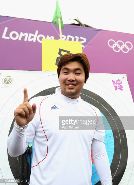 Im Dong Hyun of Korea celebrates breaking the World Record during the Men's Individual Archery Ranking Round on Olympics Opening Day as part of the...