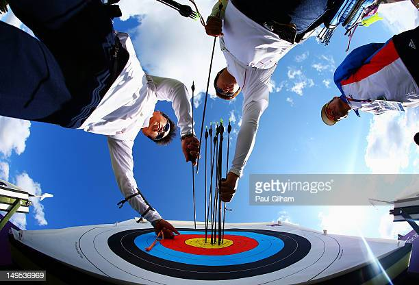 Im DongHyun of Korea retreives arrows from the board during practice ahead of the Men's Individual Archery on Day 3 at Lord's Cricket Ground on July...