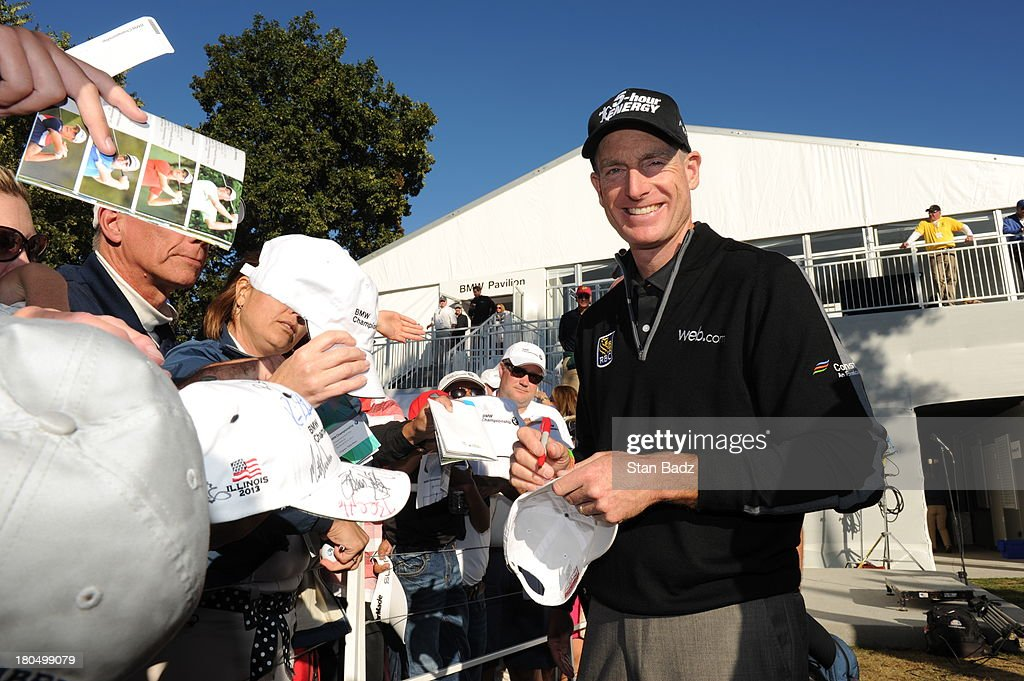 J im Furyk smiles as he signs autographs for fans after shooting a score of 59 during the second round of the BMW Championship at Conway Farms Golf Club on September 13, 2013 in Lake Forest, Illinois.