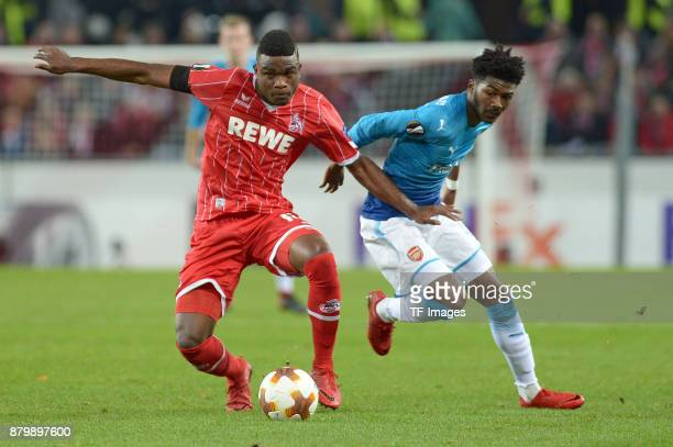 im Zweikampf Jhon Cordoba of Cologne and Ainsley MaitlandNiles of Arsenal battle for the ball during the UEFA Europa League Group H soccer match...