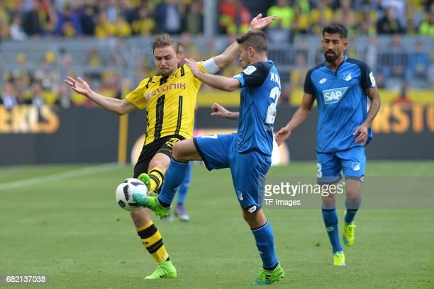 im Zweikampf Marcel Schmelzer of Dortmund Andrej Kramaric of Hoffenheim battle for the ball during the Bundesliga match between Borussia Dortmund and...