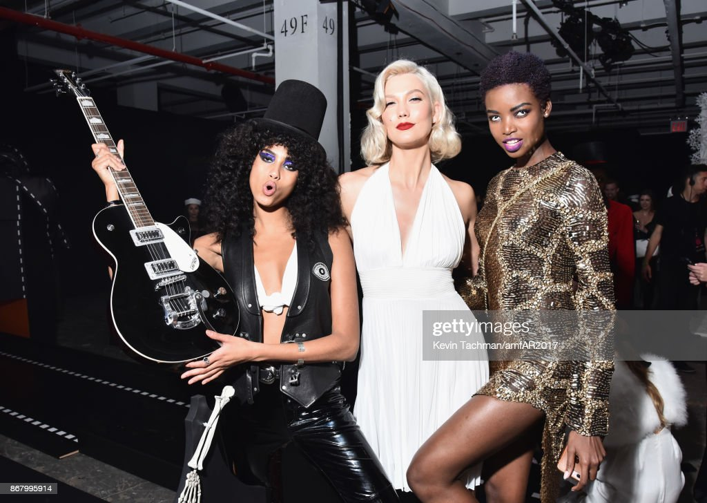 Imaan Hammam, Karlie Kloss and Maria Borges at the 2017 amfAR & The Naked Heart Foundation Fabulous Fund Fair at the Skylight Clarkson Sq on October 28, 2017 in New York City.